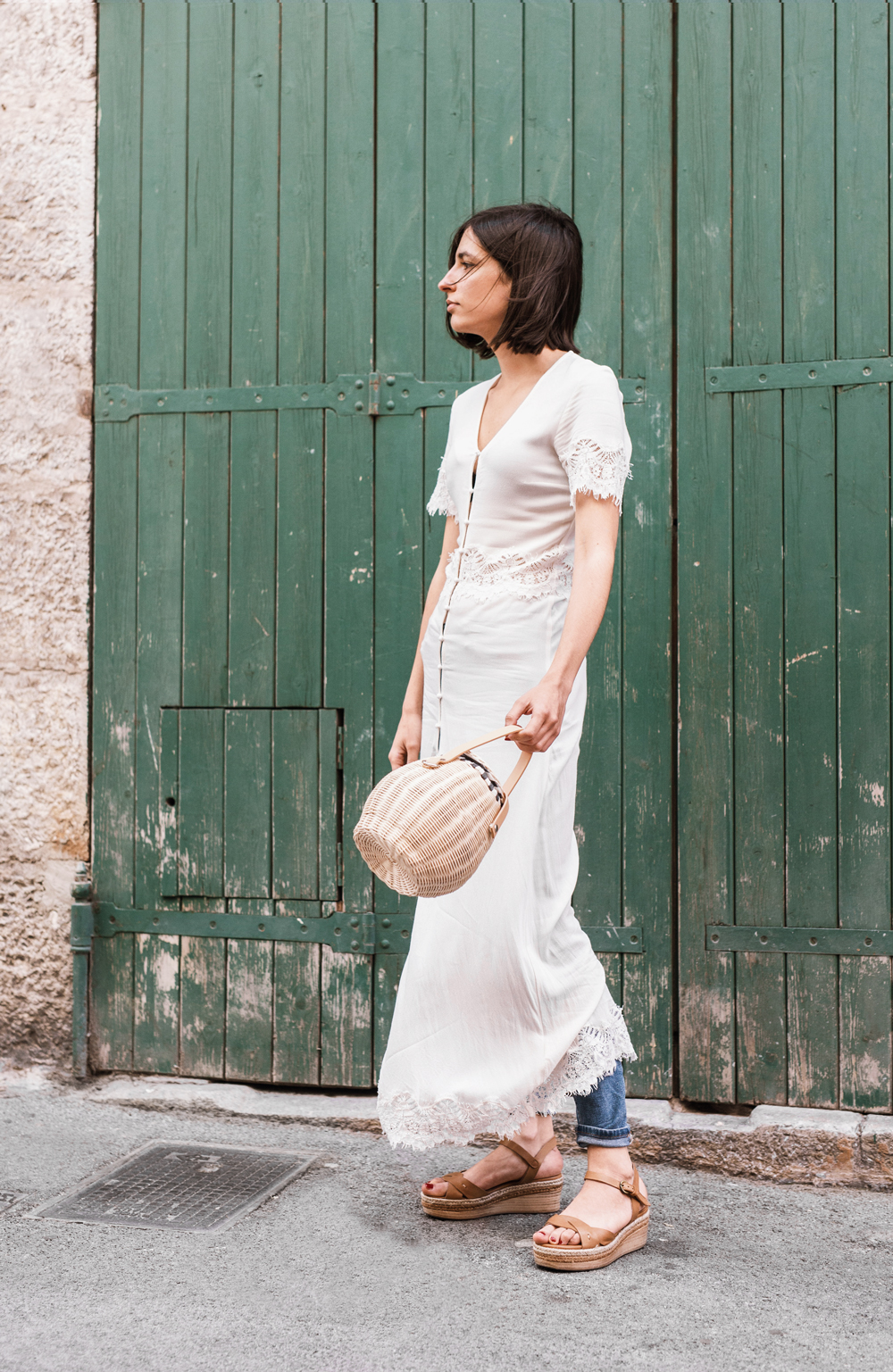 Summer outfit: The dress-over-jeans trend