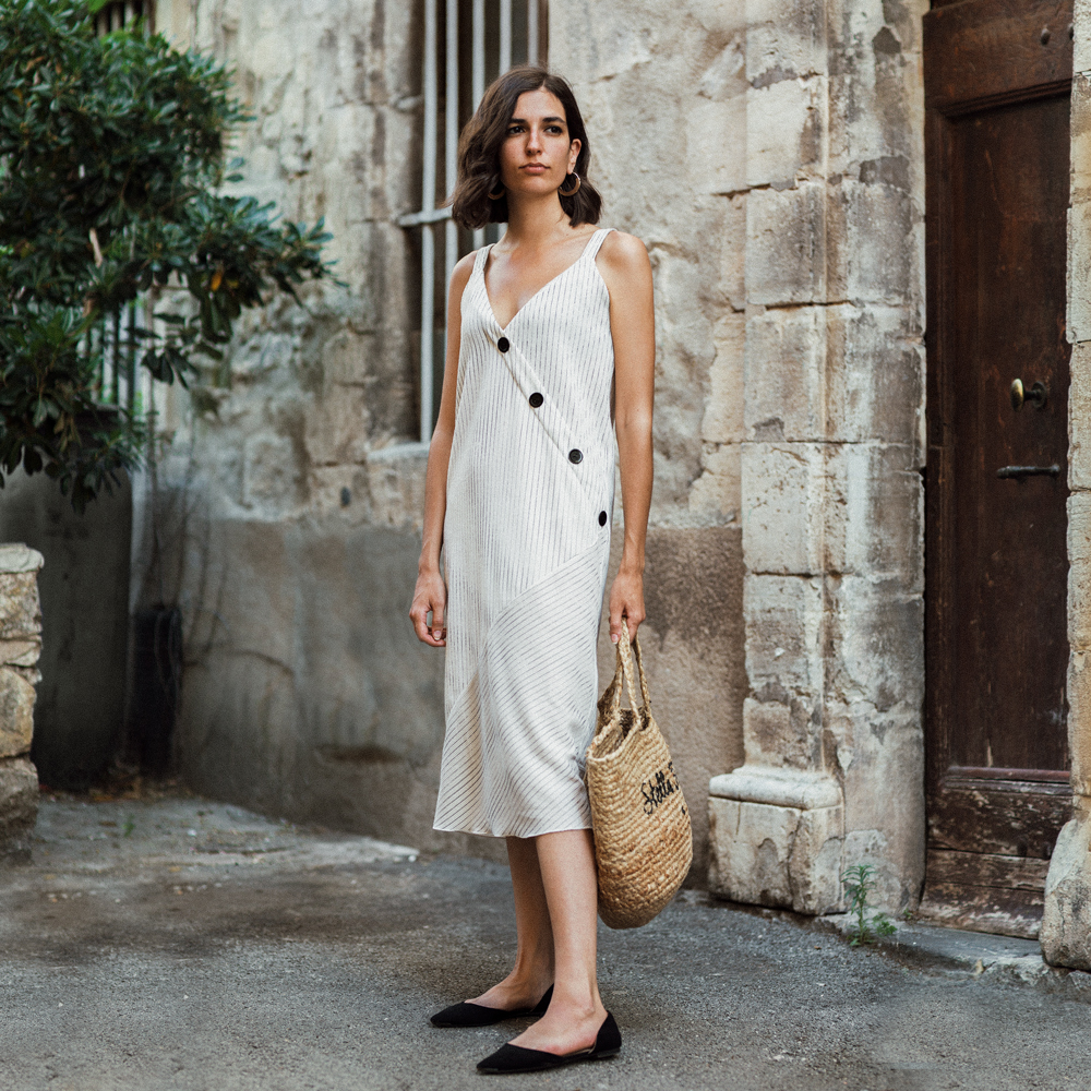 a casual dress and a straw bag: The fail proof outfit to survive a heat wave
