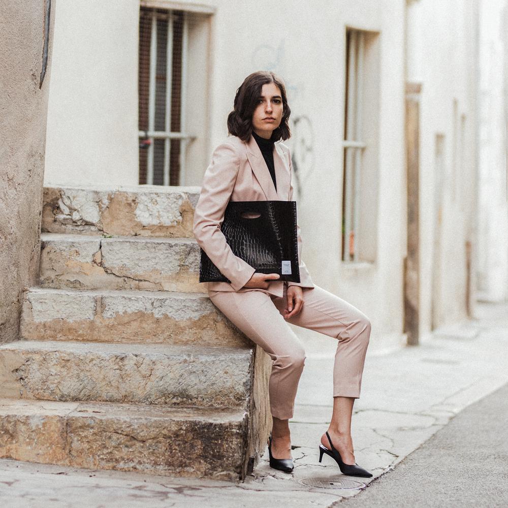 A Pink Suit And A File Bag Aria Di Bari