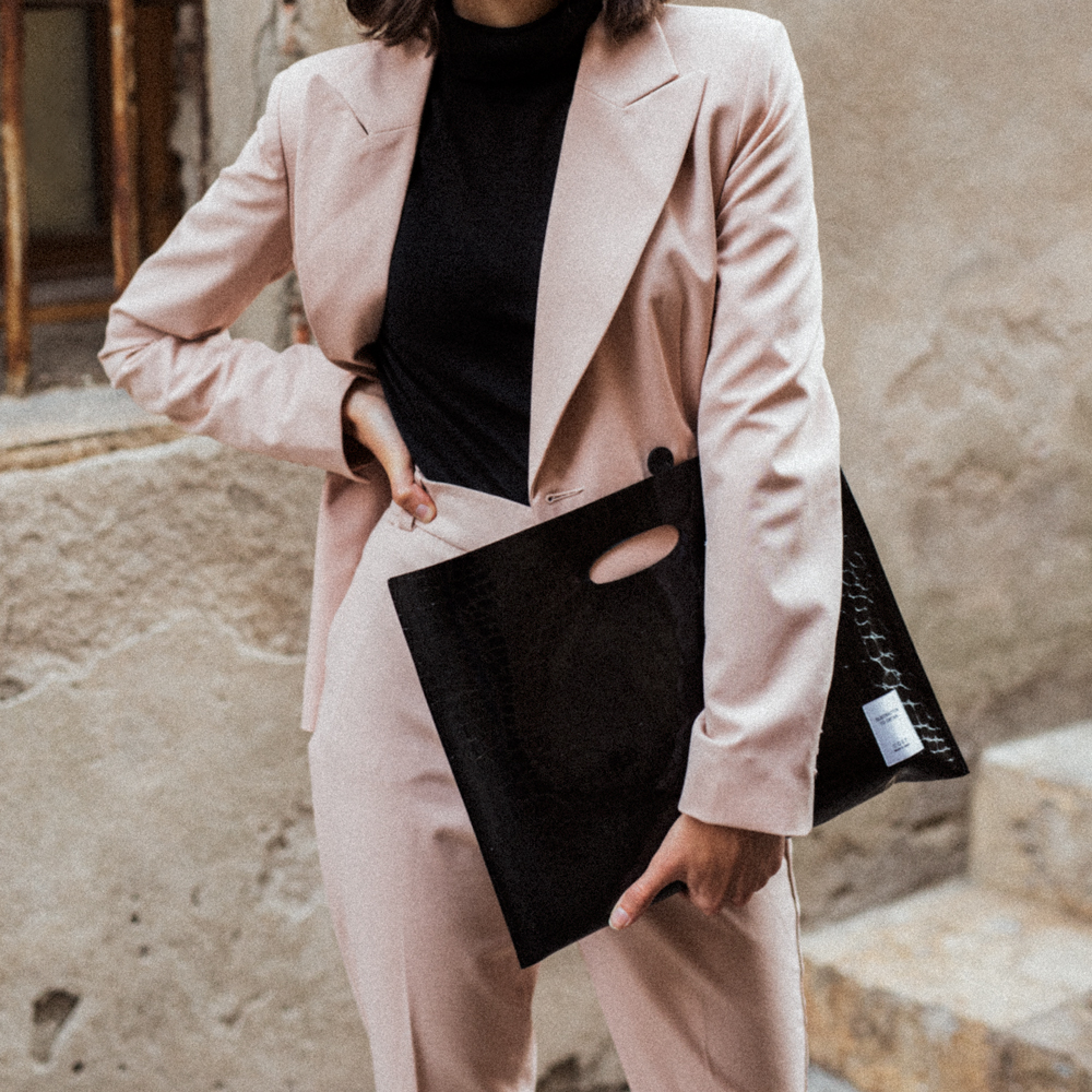 A pink suit and a file bag