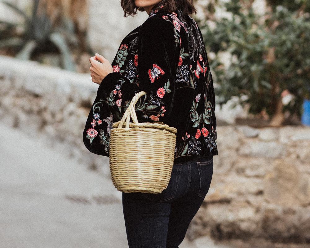 A velvet embroidered jacket and a basket bag