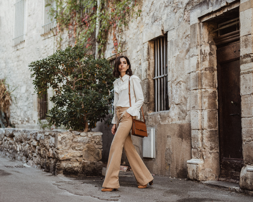 A vintage inspired blouse and beige flare trousers