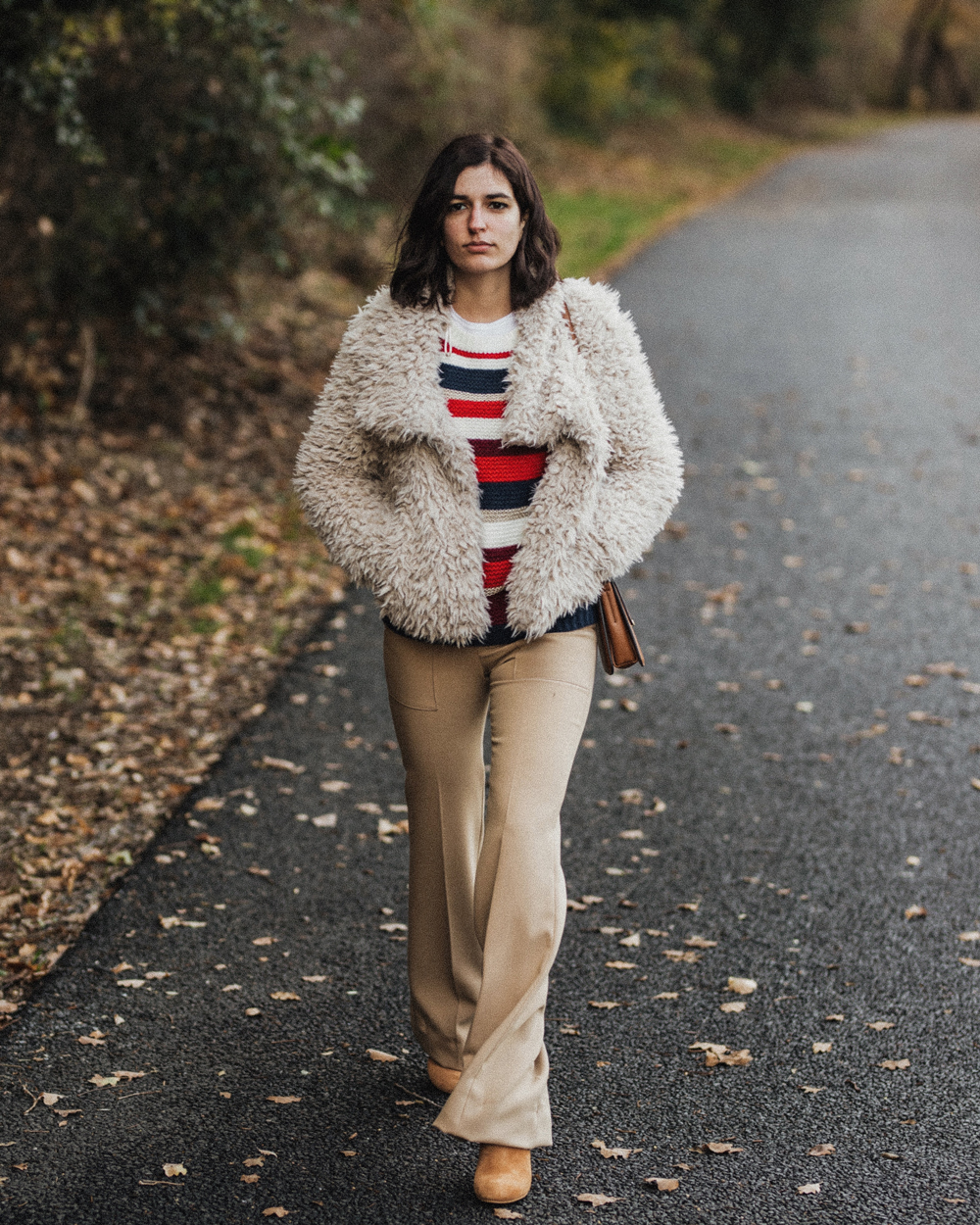 A fluffy coat and a pair of flared trousers