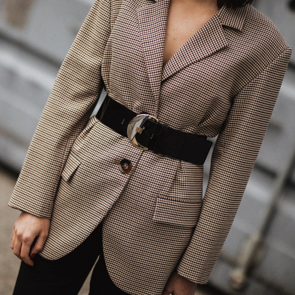 An oversized checked blazer and a vinyl waist belt