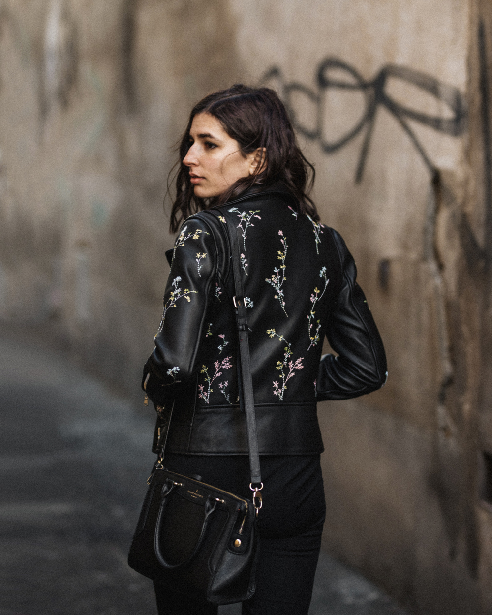 A cashmere sweater and an embroidered leather jacket