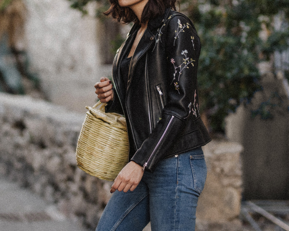 An embroidered leather jacket and a wicker basket