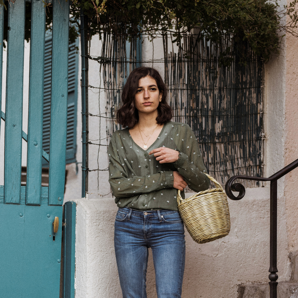 A floral blouse and a wicker bag