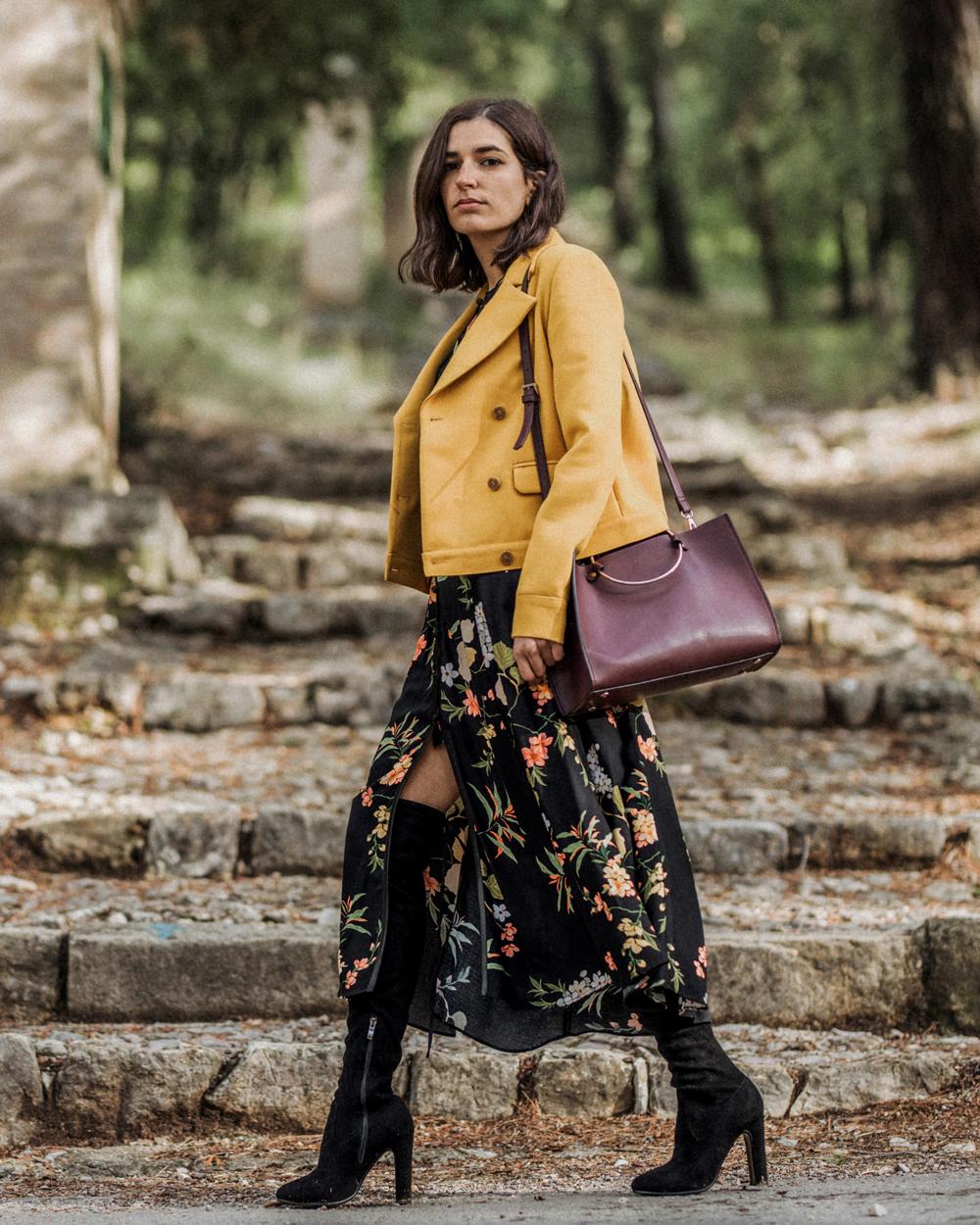 A Yellow Jacket And A Floral Dress Aria Di Bari