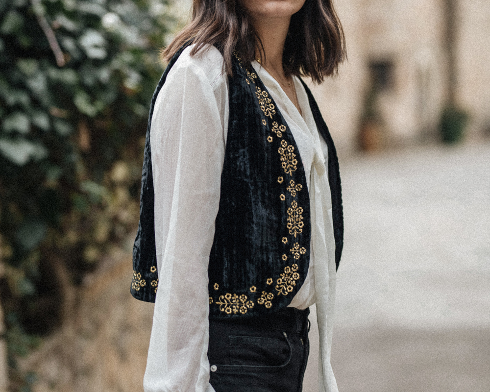 A velvet embroidered waistcoat and a pussybow blouse