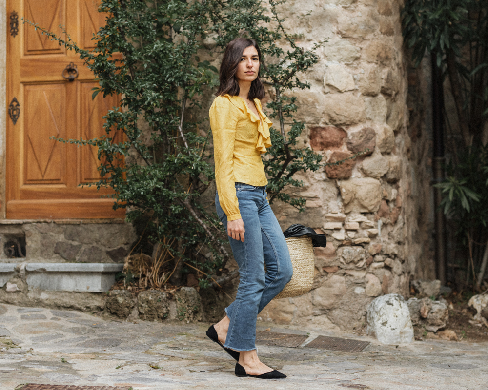 A yellow wrap top and a vintage biker jacket