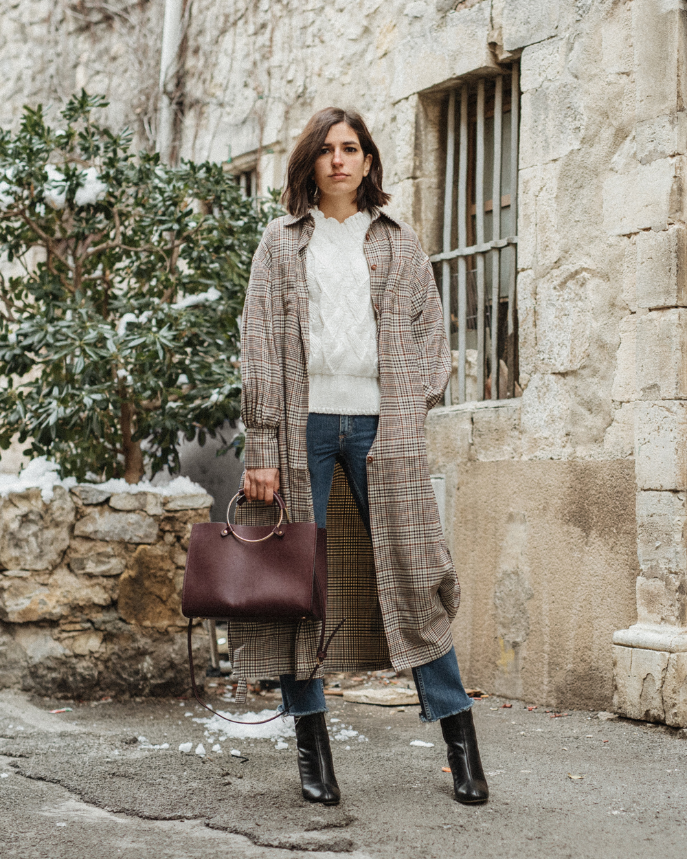 A timeless checked trench coat