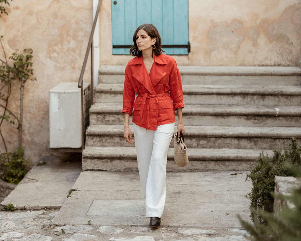 A red safari jacket and a straw bag