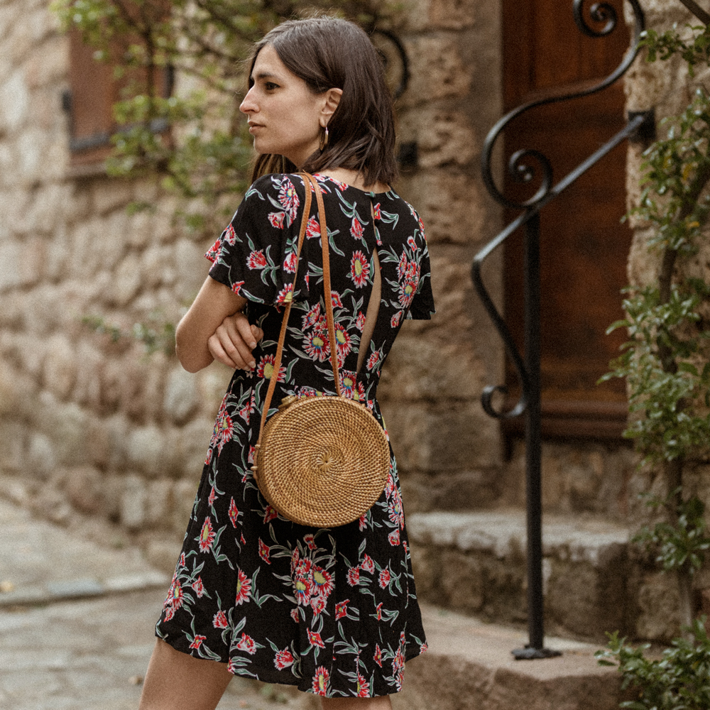 A floral dress and a straw bag