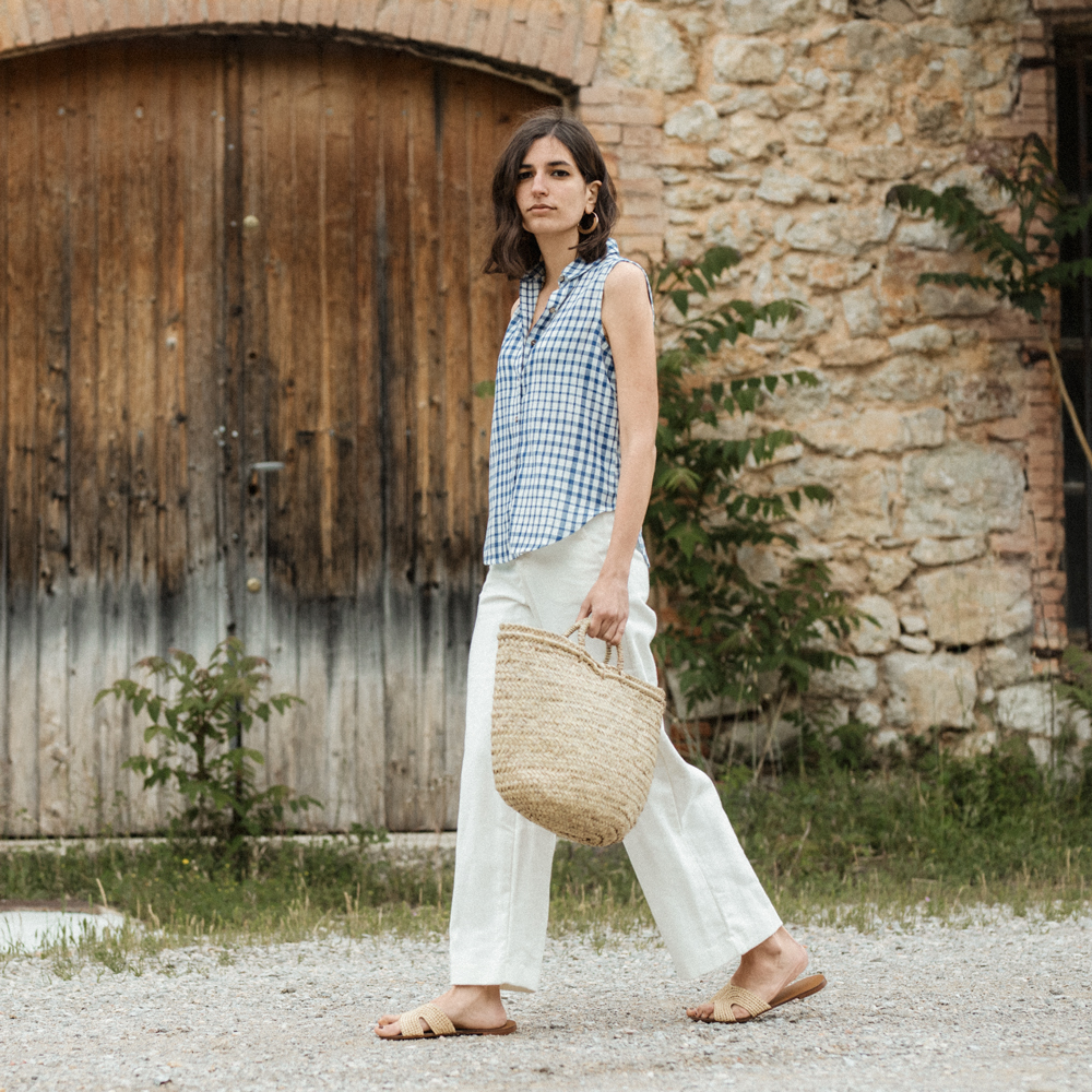 A gingham shirt and a pair of white trousers