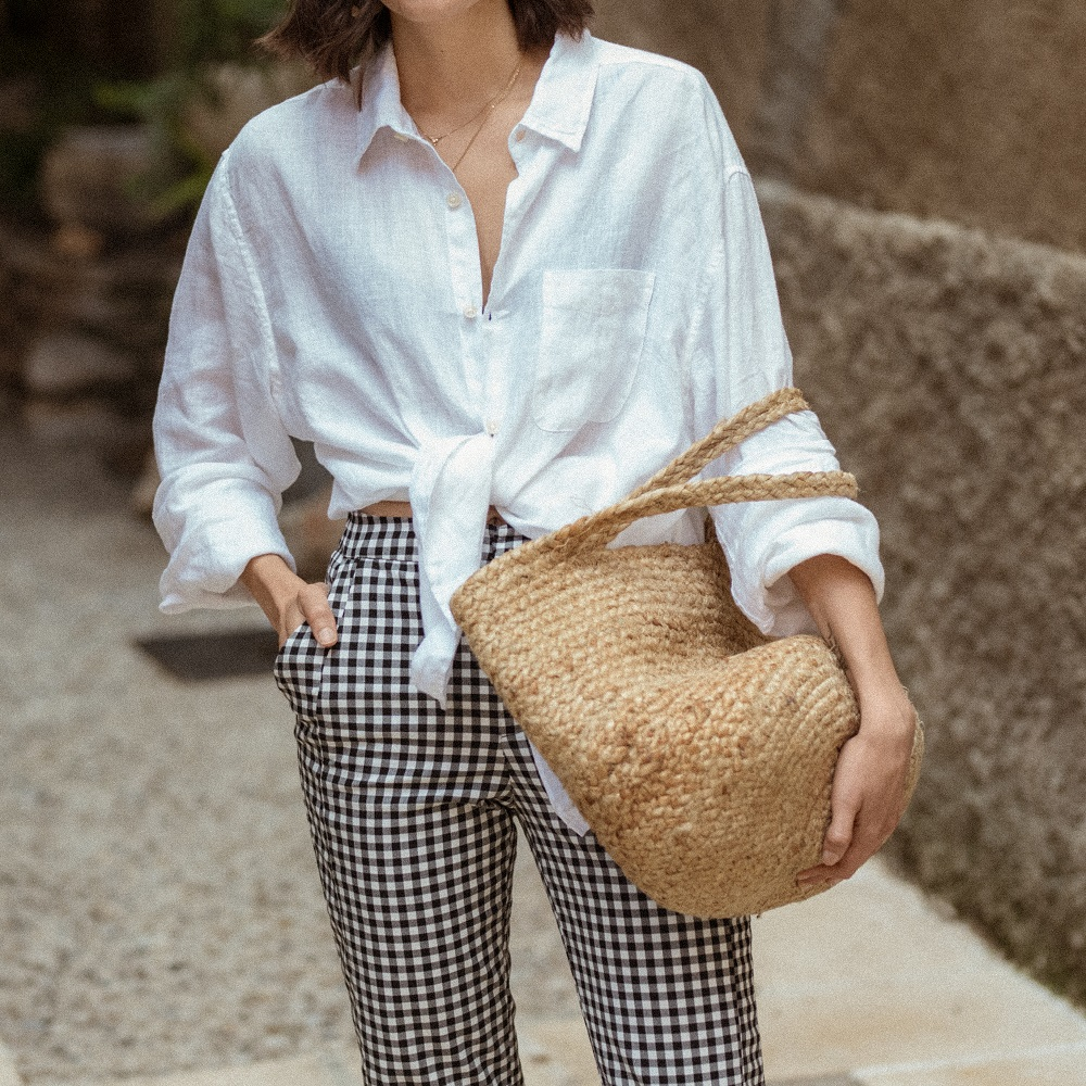 An oversized linen shirt and a pair of gingham trousers