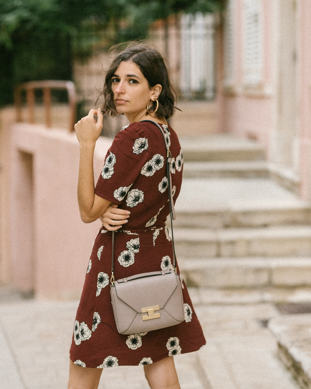 A floral wrap dress and a checked blazer